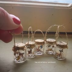 Catching butterflies in jam jars by Laura Brownhill Mini Glass Bottles, Glass Bottle Crafts, Bottle Charms, Bottle Art, Bottle Jewelry, Bottle Necklace, Jam Jar Crafts, Diy Arts And Crafts, Paper Crafts