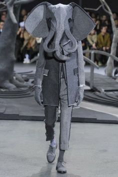 Elephant man on the catwalk. Thom Browne 2014 collection with hats by Stephen Jones.
