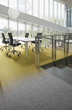 Desso Transitions carpet tile range. Fuse tile used to add accent colour.