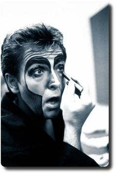 Peter Gabriel doing his makeup.   Checkout the cover of Peter Gabriel Plays Live to see his face on.  Shock the Monkey!