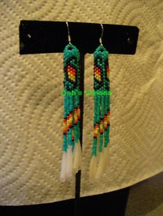 Turqouise Green Peyote stitched earrings with Dentillium fringe on Wanelo
