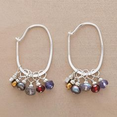 """VIVANT HOOPS--A pair of dangling gemstone hoop earrings, with a colorful medley of beautiful stones—iolite, garnet, jade and pearl—celebrating and swaying on hammered oval hoops of sterling silver. USA. Exclusive. 1-1/8""""L."""