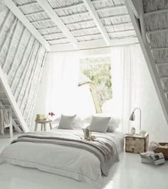 This was a very bold move to paint the thatched roof white! Beautifull white cemcrete floor!!!!!!  I think it was very well exicuted...stunning and tranquil atmostphere