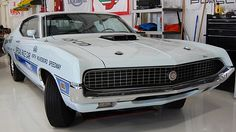 1970 Ford Torino GT NASCAR Pace Car 429/370 HP, Automatic presented as lot K73.1 at Kissimmee, FL 2015   - Delivered to Ford Motor Company as a marketing vehicle for NASCAR - These cars were loaded with options and taken to Hollman and Moody to be track prepared - This car is 1 of 501 ordered with this engine and transmission codes - Window sticker, MSO, picture of 2 pace cars at Charlotte Speedway with Richard Petty and LeeRoy Yarbrough in them with date coded caption from Ford - Deluxe Marti Report - Ram Air 429/370 HP Cobra Jet engine - Own a piece of NASCAR history - Air conditioning - Hideaway headlamps - Matching numbers engine Richard Petty, Ford Torino, Jet Engine, Ford Motor Company, Drag Racing, Nascar, Auction, Fancy