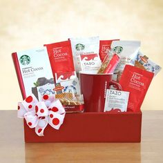 For the Starbucks Red Box. We have designed a basket of perfection! Share a cup of Tazo Passion tea in a bright red Starbucks logo mug or fill them with steaming cups of Starbucks coffees and cocoa. Enjoy them with the sweet tastes of Nonni's biscotti and Daelman's caramel wafers. Everything comes in a bright red box and is tied with a fun red and white bow.  http://cathouse.labellabaskets.com/