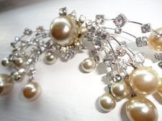 Exquisite vintage faux pearl dangle fringed rhinestone bow brooch. Metal base arms support swinging free dainty pearls adorned with clear set