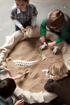 A sandpit transformed into a dinosaur dig