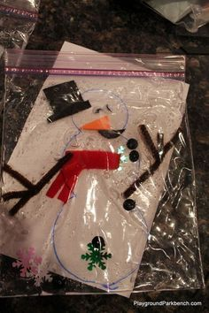 Challenge fine motor skills and engage in winter sensory activities for preschoolers with our Jumbled Snowman, suspended in a bag of Dollar Store hair gel