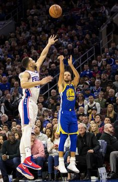 Golden State Warriors' Stephen Curry (30) shoots a 3-pointer with Philadelphia 76ers' Ben Simmons, of Australia, left, defending during the first half of an NBA basketball game Saturday, Nov. 18, 2017, in Philadelphia. The Warriors won 124-116. (AP Photo/Chris Szagola)