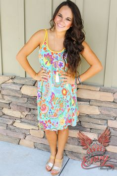 Paisley Promises Sun Dress - Say goodbye to summertime sadness in this adorable little sun dress! This bright and upbeat paisley pattern is sure to make your beauty shine from the inside out. The back features a straight cross back tie for an extra cute boost from behind! Pair this dress with your favorite envy wedge or sandal for a complete summer look!  - available online at http://www.envyboutique.us/shop/paisley-promises-sun-dress/ #Envy #Boutique #chic #fashion #fashiont