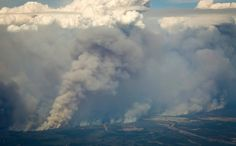 May 6, 2016 JEFF MCINTOSH/THE CANADIAN PRESS, VIA ASSOCIATED PRESS Canadian Wildfire Gives No Quarter As fire engulfed the Alberta oil sands region on Thursday, some people pushed from Fort McMurray had to flee again. Page A8.