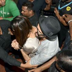 Ranveer Singh protecting Deepika Padukone from crowd.OMFG. that is so adorable of him