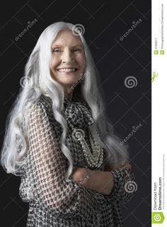 women with long gray hair | ... smiling senior woman with long gray hair against black background