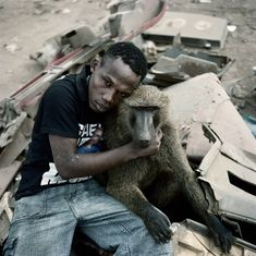 Pieter Hugo shot the series 'The Hyena & Other Men' in Nigeria. Pieter was captivated by the first pictures of the 'hyena men' that he came across randomly. He went to live with them on the periphery of Abuja in a shantytown – a group of men, a little girl, three hyenas, four monkeys and a few rock pythons.