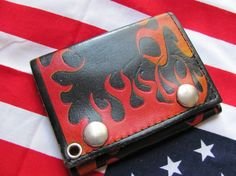 http://www.etsy.com/listing/67236634/flaming-black-leather-tri-fold-wallet?ref=sr_gallery_10&sref=&ga_search_submit=&ga_search_query=wallets+mens&ga_view_type=gallery&ga_ship_to=US&ga_page=4&ga_search_type=vintage&ga_facet=vintage