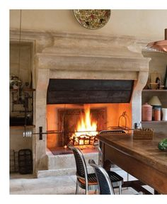 Fireplace in the kitchen (with a rotisserie tool??)