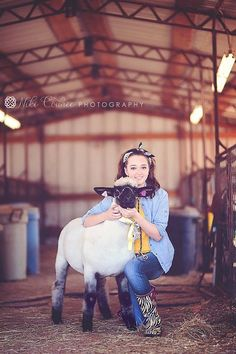 I know this is a lamb, but this would be cute with my show goats maybe ya senior picture???