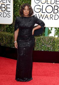 Uzo Aduba in a shimmering black gown.