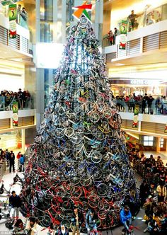 Bike Christmas Tree | A 12-metre tall tree made with 230 bicycles installed at a shopping mall in Shenyang, China. - photo via ArchiEli on fb