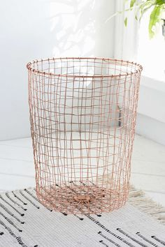 Cabo Copper Wastebasket - Urban Outfitters - $40 / Get a regular wire basket and spray paint it copper.