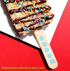 How cute would these be used for a birthday party favor! BOYS Rainbow Yummy JUMBO Rice Crispy Treat Sticks  by thebakersconfections