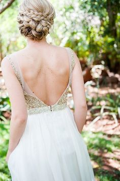 Intricately twisted chignon? Check. Asymmetrical wrap-around bridal braid? Check. Abso-freaking-amazing wedding upstyle? CHECK! This wedding upstyle with sweet face framing tendrils worn by Mari has it all! {Photographed by D'amor Photography.} Confetti Daydreams Wedding Blog. Click to see more! Like us on http://www.Facebook.com/Confettidaydreams #wedding #hair #upstyle #braid #bun #updo