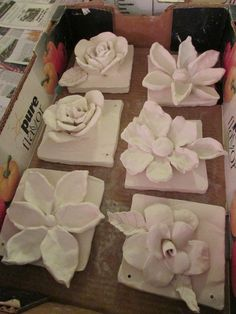 "ceramic flower sculptures; approx. 7"" X 7""; lesson by art teacher: Susan Joe"