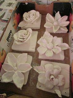 """ceramic flower sculptures; approx. 7"""" X 7""""; lesson by art teacher: Susan Joe"""