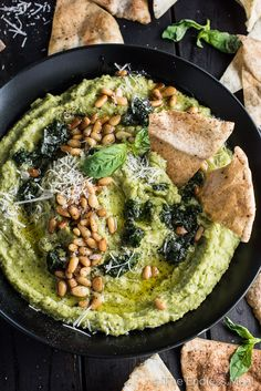 Pesto Hummus is delicious served with homemade pita chips for a party appetizer, packed as a school lunch, spread on a sandwich, or as a dinner side dish. | theendlessmeal.com