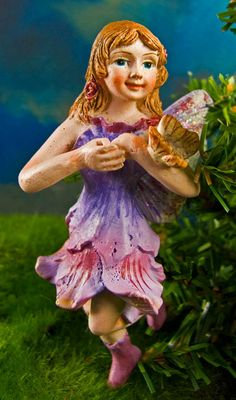 Butterfly Fairy Pot Hanger - $3.95  Flit away into a world of enchantment with the butterflies and fairies. Fairies love fluttering around with colorful butterflies. If you look closely at the butterflies flying through your garden you might just be able to catch a glimpse of magical fairy wings.     We offer two sizes of beautiful butterfly themed fairy pot hangers to enchant your house plants, home and miniature fairy gardens. Please select your desired size above by clicking the add to…