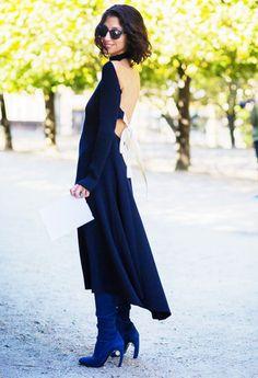Yasmin Sewell wears a backless Céline midi dress with knee-high boots