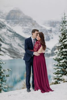 Lake Louise in October: Magical snowy Engagement Photography session during prettiest time of year in the mountains when autumn meets winter.