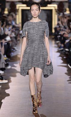 Winter 2015  Look 19- Stella McCartney - Black Tweed Coating Ayana Dress, Pure White Brass & Enamel Pearl Earrings and Multicolour Brocade Boots.