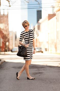 Black/White striped dress. Black and tan flats. Gold and Black accessories.