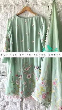 Beautiful olive green color designer kurti with floral and flying bird design hand embroidery work all over. Indian Suits, Indian Attire, Punjabi Suits, Salwar Suits, Pakistani Fashion Casual, Indian Fashion, Kurta Designs, Blouse Designs, Embroidery Suits Punjabi