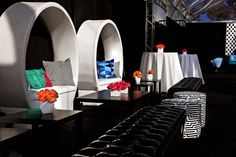 On the first of two nights of parties, black and white decor included pops of color, plus checkered accents. Photo: Nadine Froger Photography