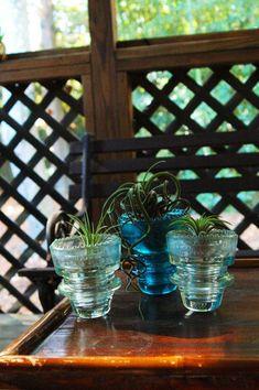 repurposed antique electric line insulator vase