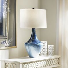 This shapely oversized table lamp makes a big, beautiful statement wherever it takes center stage, as a large living room table lamp or as the perfect bedroom lamp. The graceful base looks like ceramic, but it's actually made of metal hand finished in an ombre of silvery blue enamel hues. We echoed the soft curves with a White Linen Drum Shade. This blue and white lamp is elegant and fits any contemporary decorating style. #BlueandWhiteDecor #BlueandWhiteLamp #LivingRoomLamp Kitchen Lighting Design, Kitchen Lighting Fixtures, Dining Room Lighting, Bedroom Light Fixtures, Bedroom Lamps, Lamps In Living Room, Blue And White Lamp, Glam Master Bedroom, Blue Table Lamp