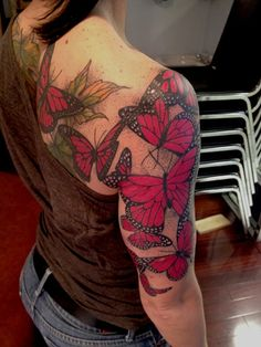Tattoo: arm, shoulder, back; butterflies and leaves