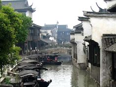 Located in the city of Tongxiang, north of Zhejiang Province, Wuzhen is a famous ancient water town with a history of two thousand years. It lies within the three city triangle of Hangzhou, Suzhou and Shanghai. Hangzhou, Chinese Gate, China, Shanghai, Scenery, Around The Worlds, Houseboats, Tours, River