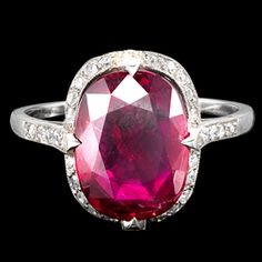 Burmese cushion shaped ruby 4.03cts and diamond cluster ring