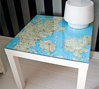 Glass, map of Denmark, table (looks like LACK from Ikea).