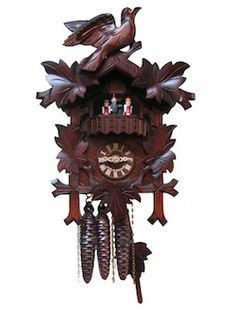 The bird cuckoos on the hour and half hour. After it cuckoos it will play one of 2 songs while the dancers rotate.   Six feet of chain will hang below the clock with three pine cone shaped cast weights.  Wooden dial, hands, and cuckoo bird. Walnut Stain.   Night Shut Off Lever. Made in Germany.  Genuine Certified Black Forest Cuckoo Clock. 16 Inches.