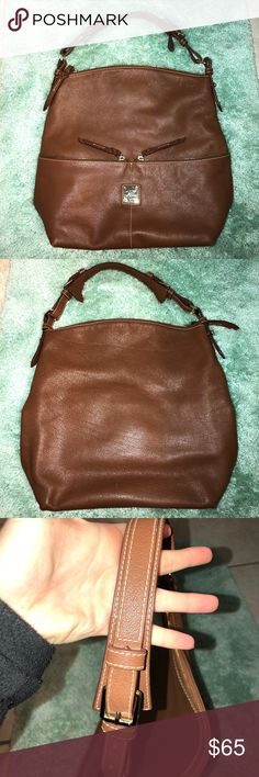 dooney and bourke leather handbag beautiful dooney and bourke leather bag in camel brown! some wear to the leather from previous use, but still in great condition! beautiful red/white checked interior. lots of pockets for extra storage! Dooney & Bourke Bags Shoulder Bags