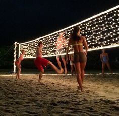 String lights on a volleyball net at night, great idea for birthday or spring/summer party for teens, tweens, youth or church groups. Perfect for an end of the school year party celebration! (End Of Summer Party) Backyard Games, Outdoor Games, Outdoor Fun, Backyard Projects, Backyard Ideas, Craft Projects, Backyard Designs, Outdoor Party Decor, Indoor Beach Party