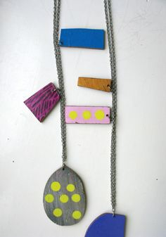 Pala pendant by Jenni Rope www.napabooks.com A handmade unique pendant made by Helsinki-based artist Jenni Rope.  Materials:  3 pieces of MDF board  Size of the biggest piece 7 x 10 cm  Painted with acrylic paints, varnished Chain length 90 cm