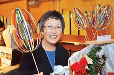 Festivities: Marjory Kamiya displays her handmade ribbon balls/stress relievers at the annual Nikkei Place craft and bake fair on Nov. Thing 1 Thing 2, How To Relieve Stress, Balls, Photo Galleries, Fair Grounds, Ribbon, Display, Crafty, Gallery