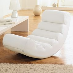 With soft padded waves, this rocking chair makes for relaxing in style. Just lie back and relax!
