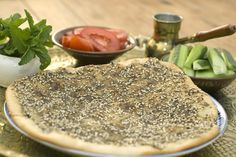 Manakish - delicious Lebanese bread with Zaatar spice. The flavor will haunt you - in a good way :)