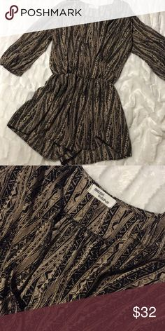 Tribal romper Super cute tribal romper by million bullpup. Size large but fits more like a medium. 3/4 sleeves with elastic. In very gently worn condition. No stains tears or defects. Bundle to save💕💕💕 Million bullpup Dresses